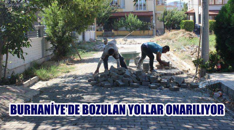 BURHANİYE'DE BOZULAN YOLLAR ONARILIYOR